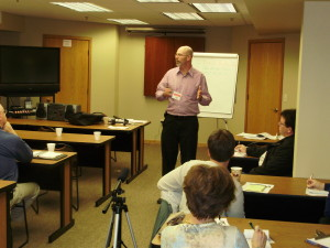 Fort Collins Business Coach Sean McCarthy is coaching small business owners in this photo.